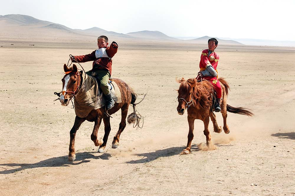 An exciting horse race during a Nadaam in Zorgol.
