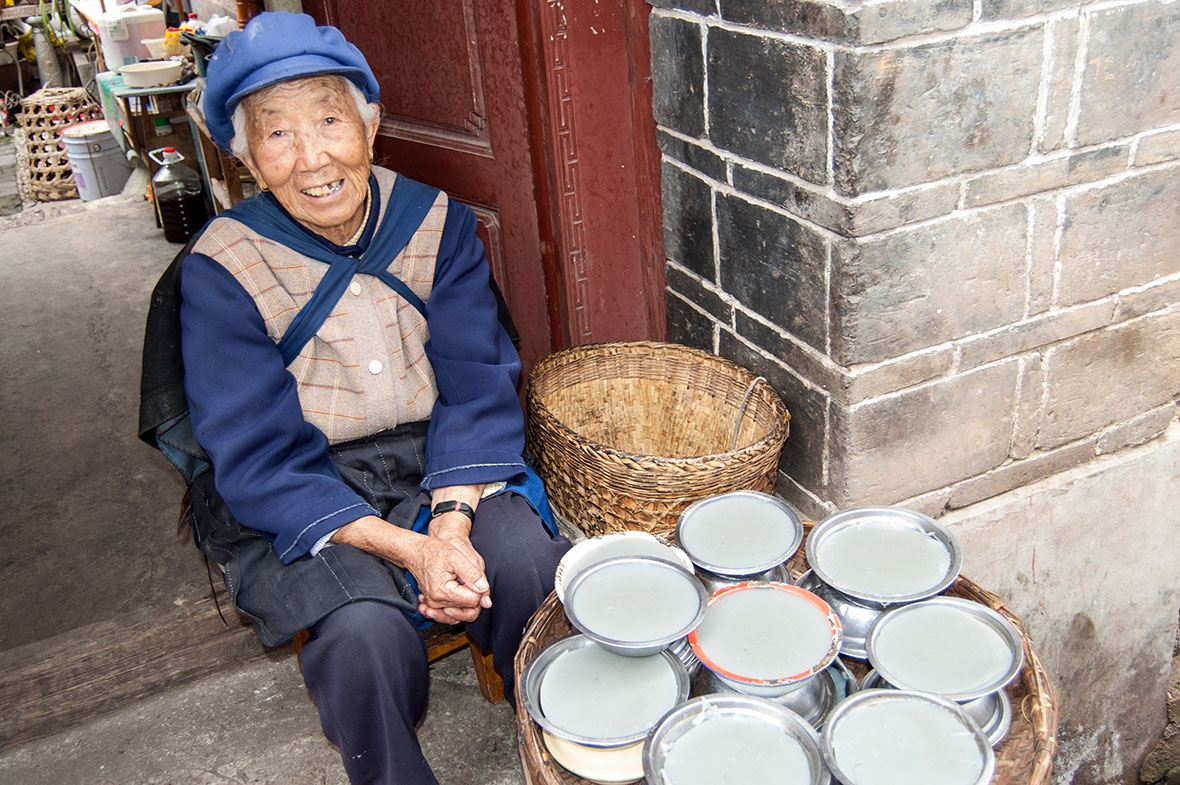 The 90 year old mother of the village Shaman.