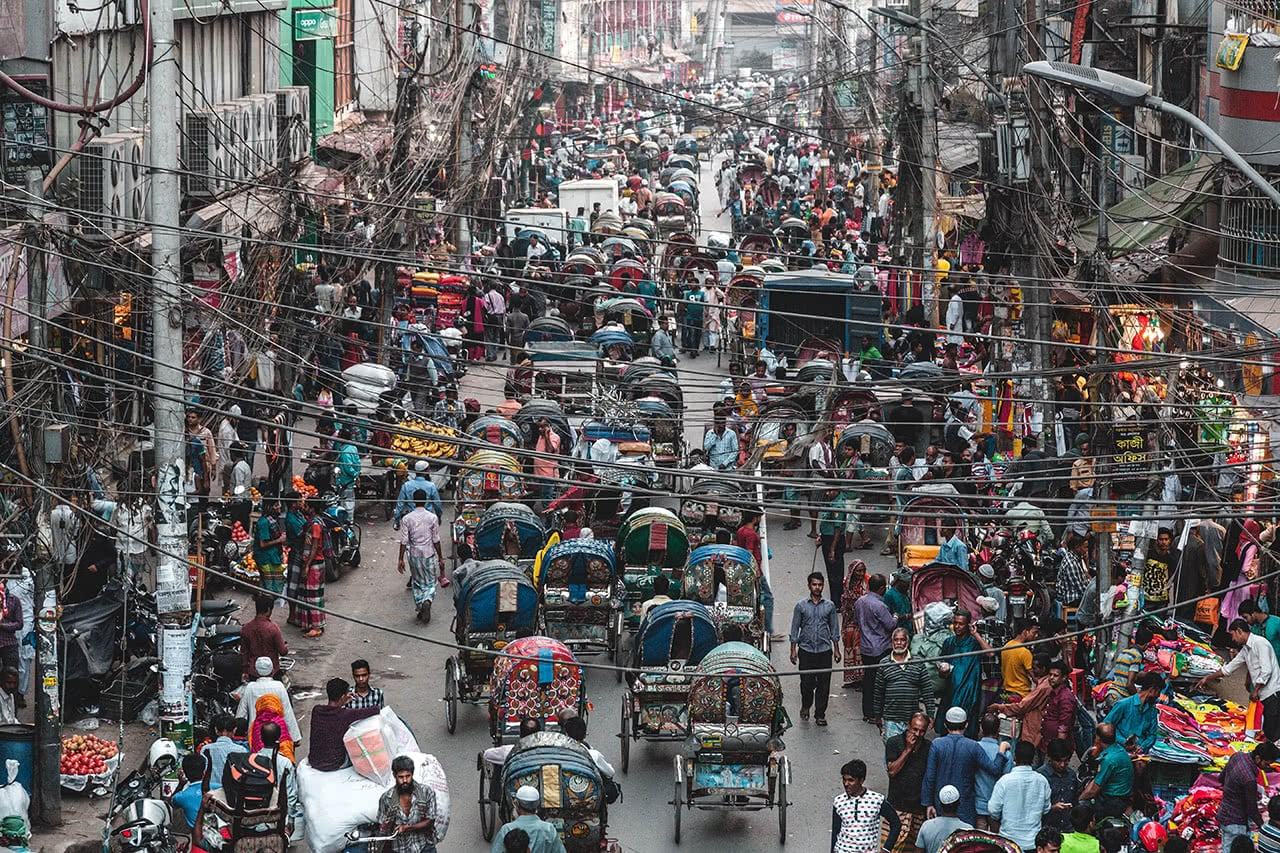 Choking traffic in Dhaka with thousands of rickshaws and cars.
