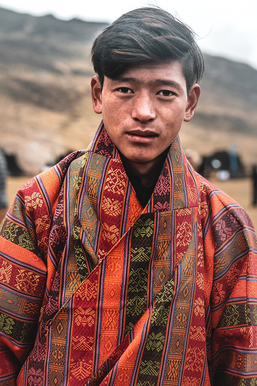 Layap boy dressed in traditional clothing for the Royal Highlander Festival in Laya, Bhutan.
