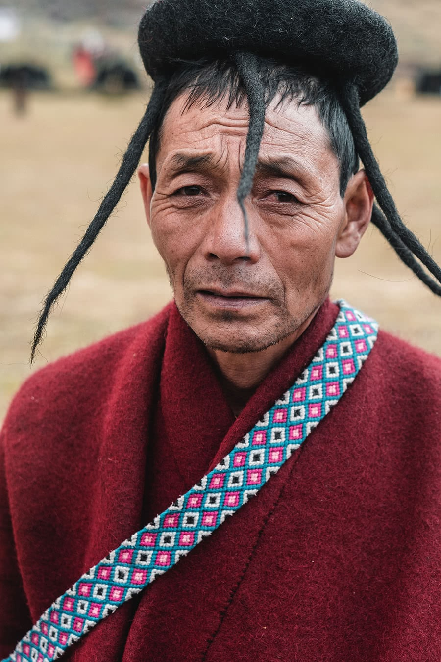 A man from the Brokpa minority with unique tufts of hair, attends the Royal Highlander Festival in Laya, Bhutan.