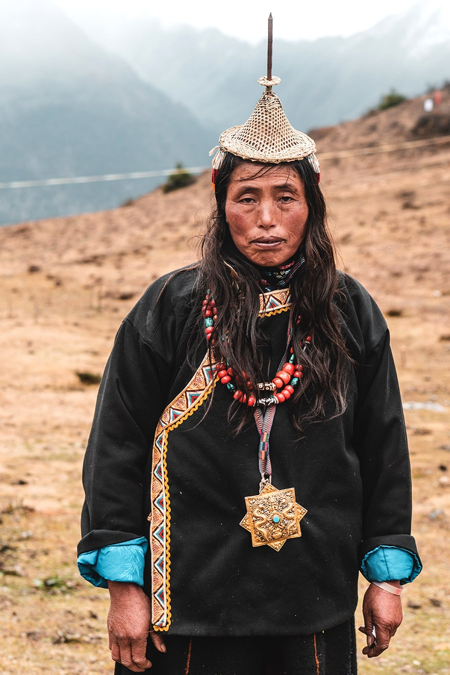 Layap woman wearing her traditional cone hat in Laya, Bhutan.