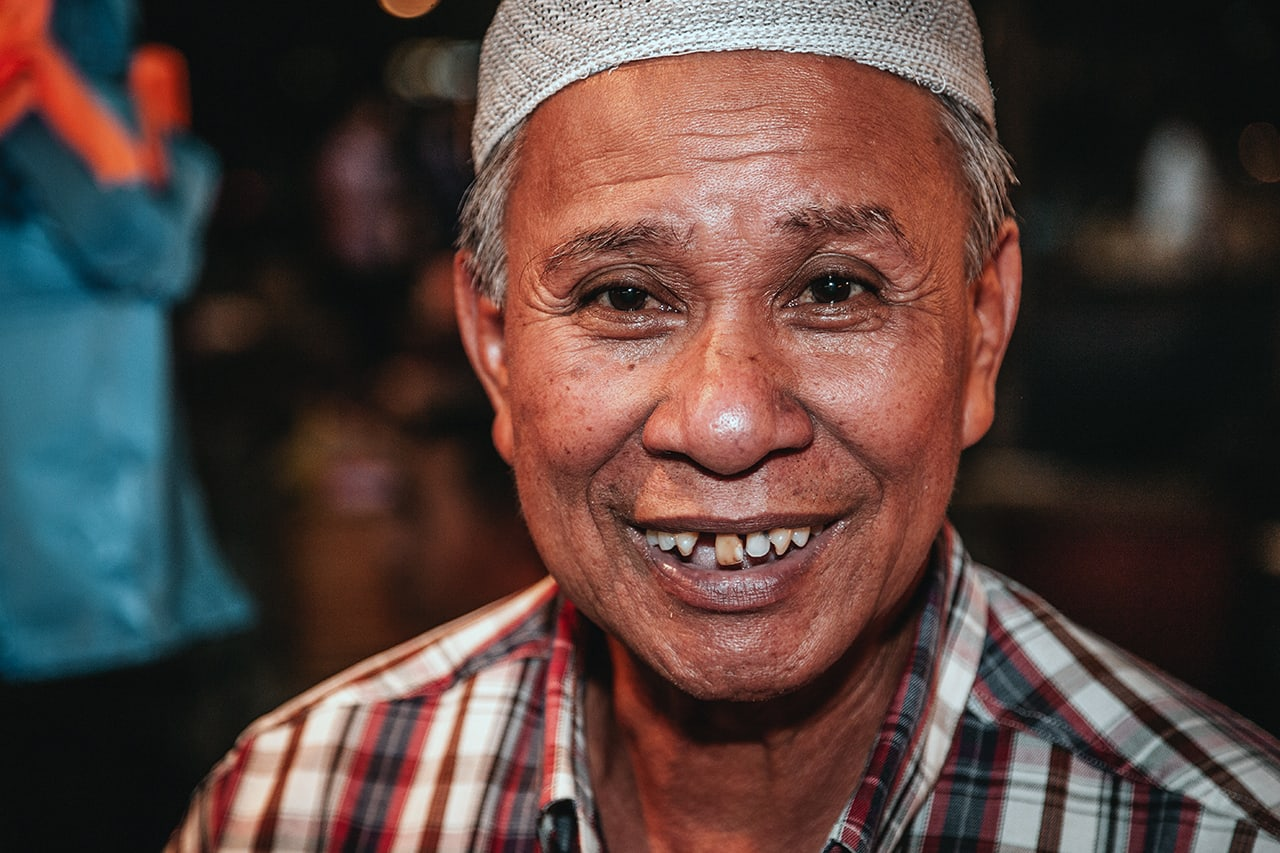 Portrait of a man at Pasar Gadong night market in Bandar Seri Begawan, Brunei.