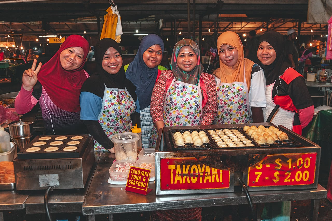 Friendly workers at Pasar Gadong night market in Bandar Seri Begawan, Brunei.