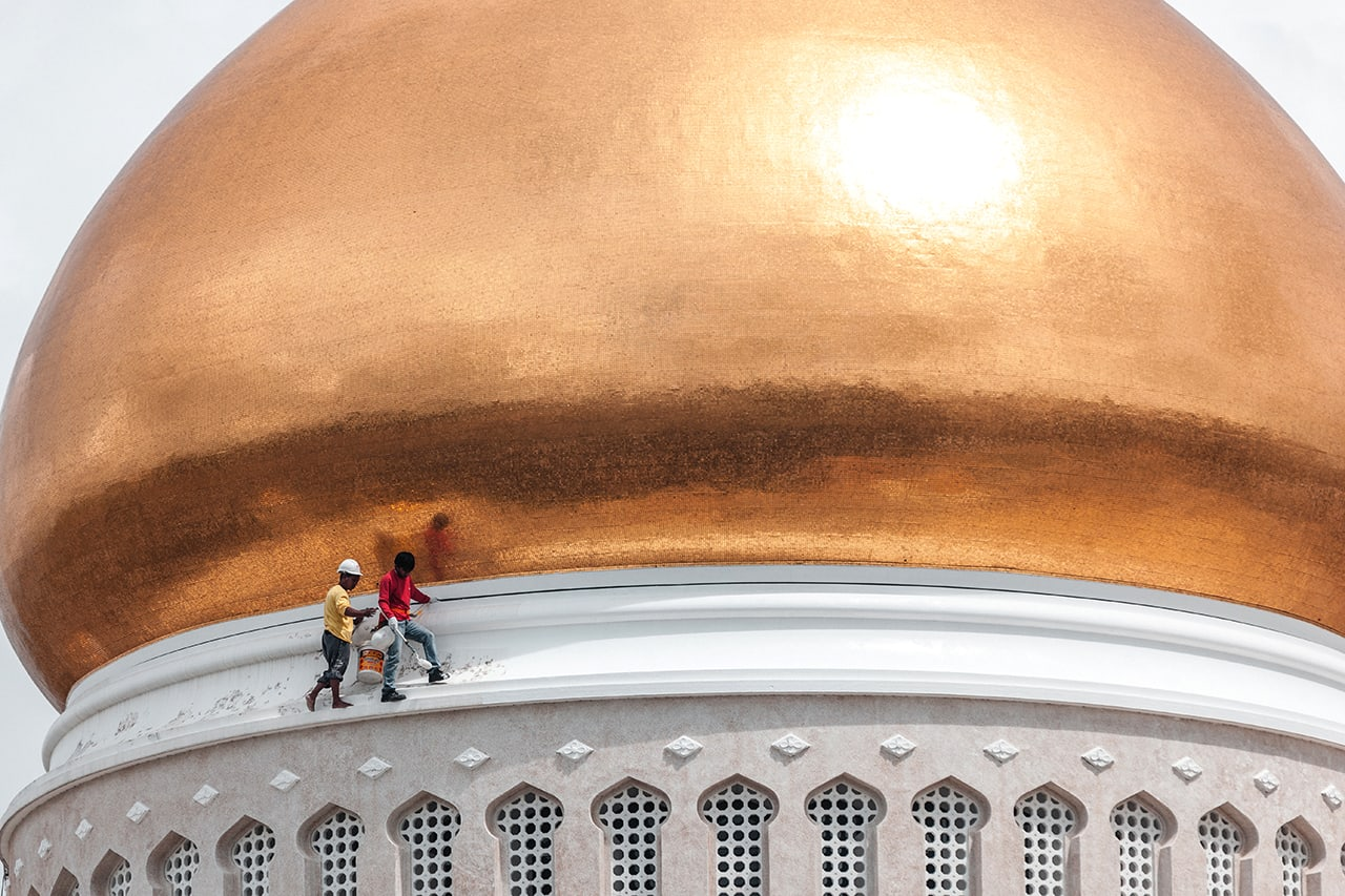 Workers cleaning the golden dome of the Omar Ali Saifuddien mosque in Bandar Seri Begawan.