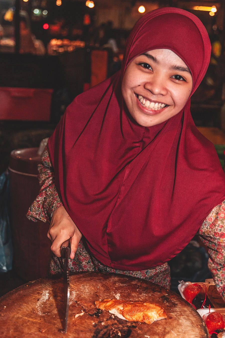 Smiling worker at Pasar Gadong night market in Bandar Seri Begawan, Brunei.