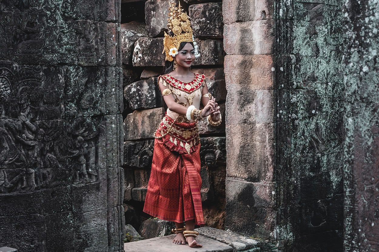 An apsara dancer posing for photographers at Bayan temple, Siem Reap.