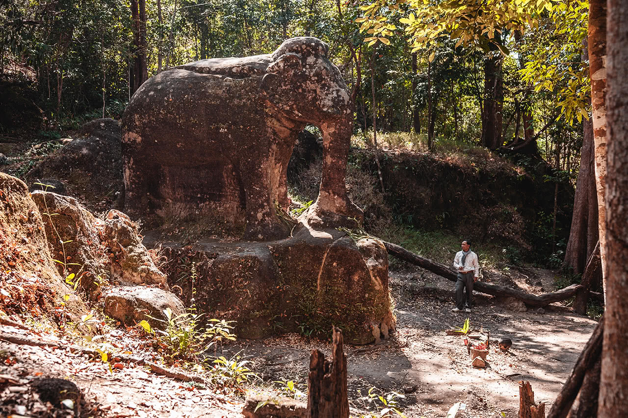 Srah Damrie, a large stone elephant carving located in Phnom Kulen, Cambodia.