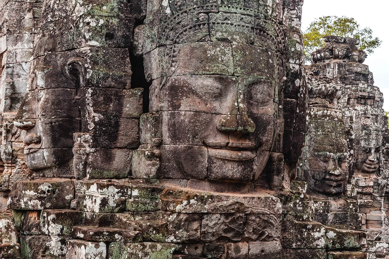 Faces carved out of stone dominate Bayon temple in Siem Reap, Cambodia.