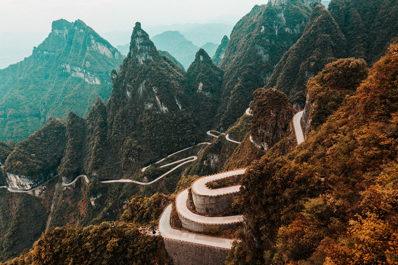View from the longest cable car in the world of the curvy road that leads to Tianmen mountain in China.