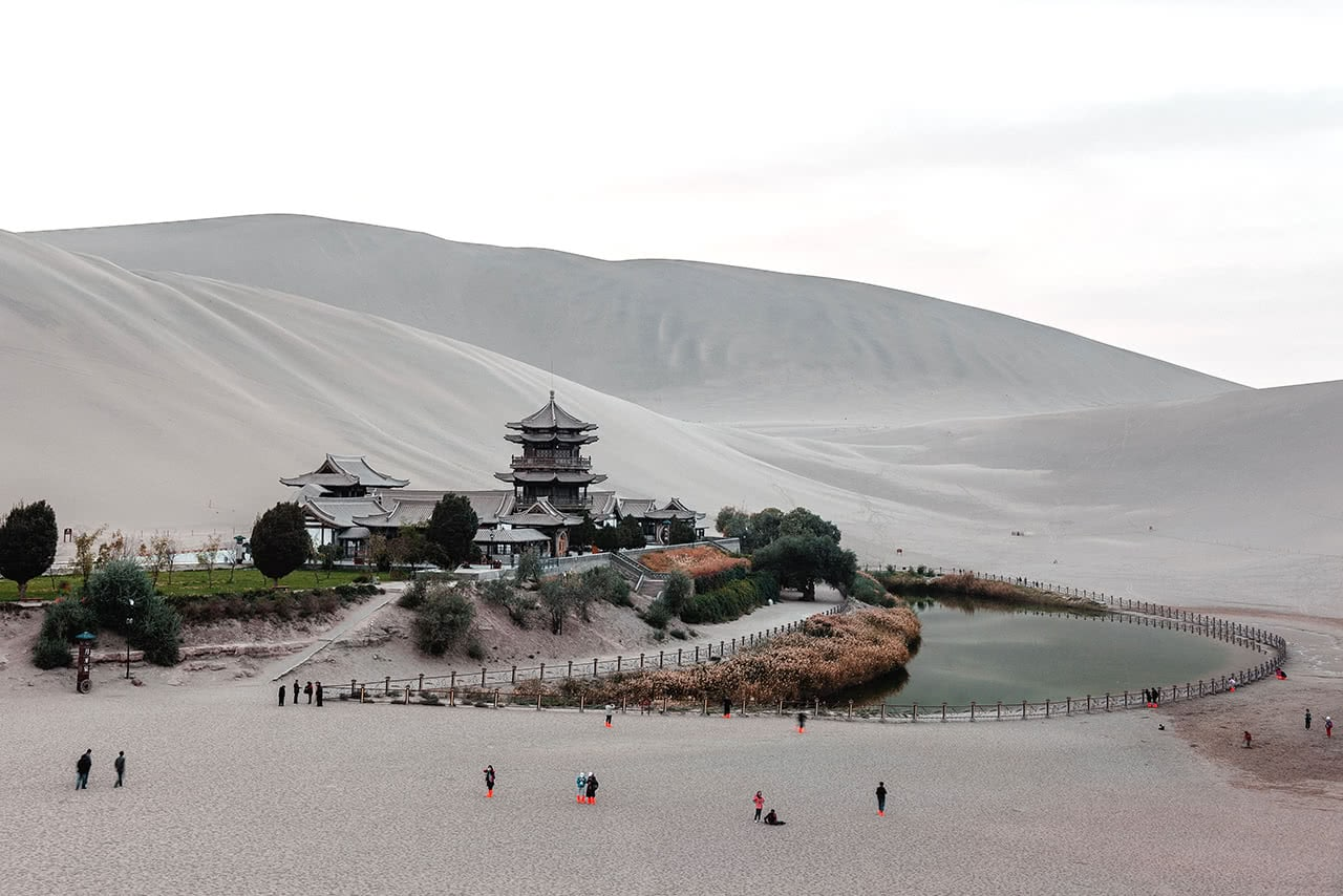 Sunset at Crescent Lake set in the sand dunes of Dunhuang, China.