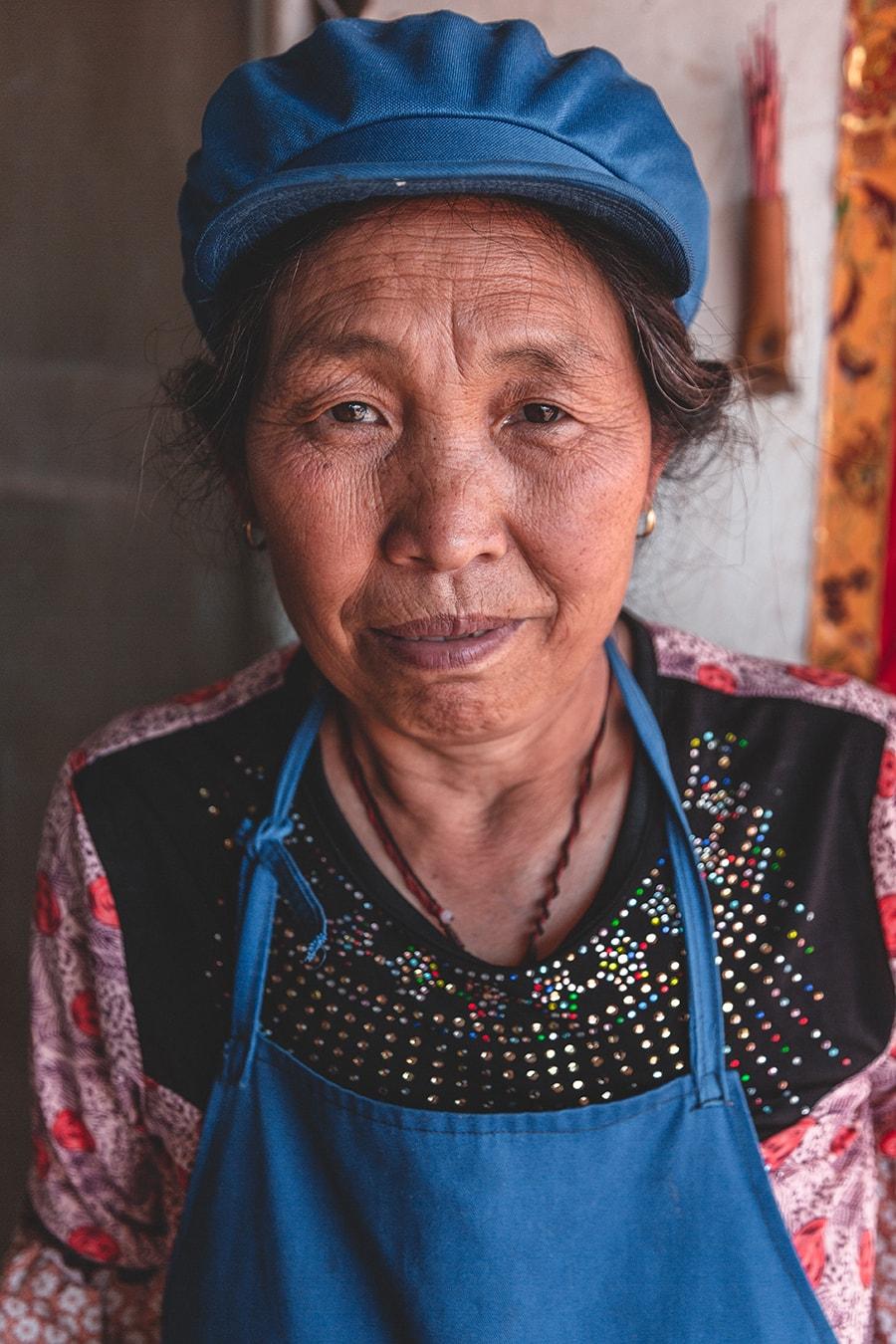Woman at Zhuang Long, Yunnan, China.