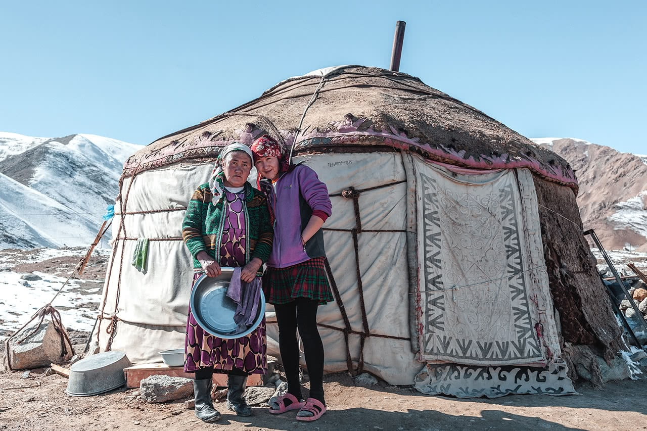 A Kazak mother and daughter outside their yurt at Karakul Lake, in western China near the border with Tajikistan.