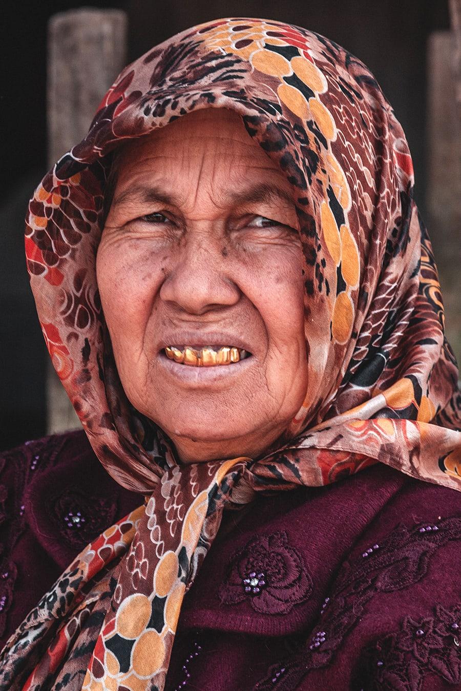 Woman at the Yekshenba Livestock market in Kashgar, China.