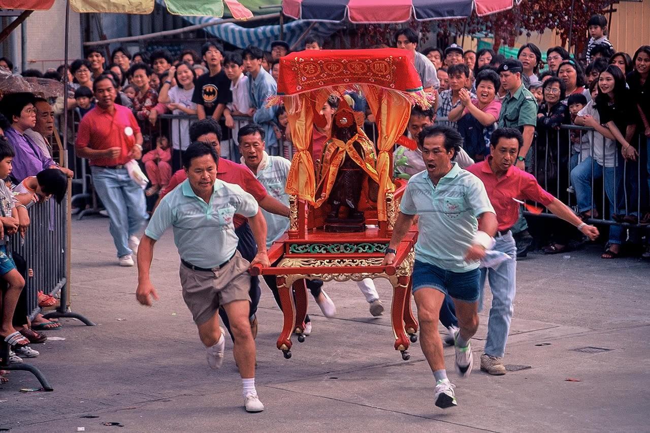 Race to Pak Tai Temple carrying Taoist deities at the Bun Festival in Cheung Chau, Hong Kong.