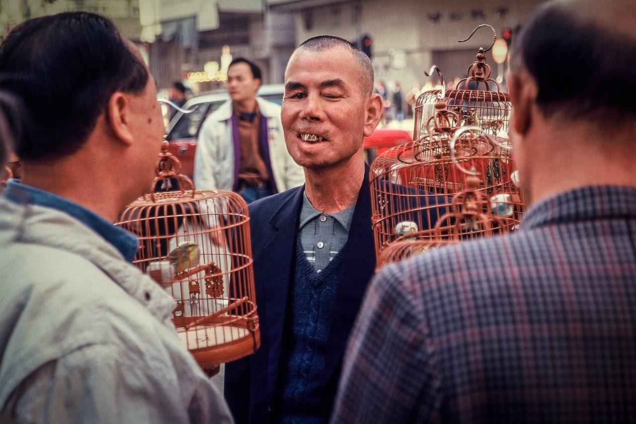 Men walking their birds at the Yeun Po Street Bird Garden, Hong Kong.