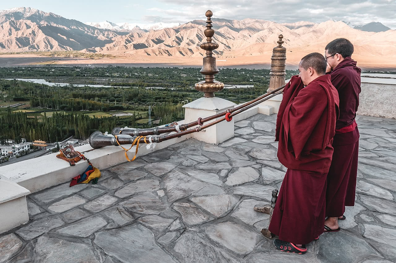 Monks blowing horns at Thiksay Monastery, Ladakh, India.