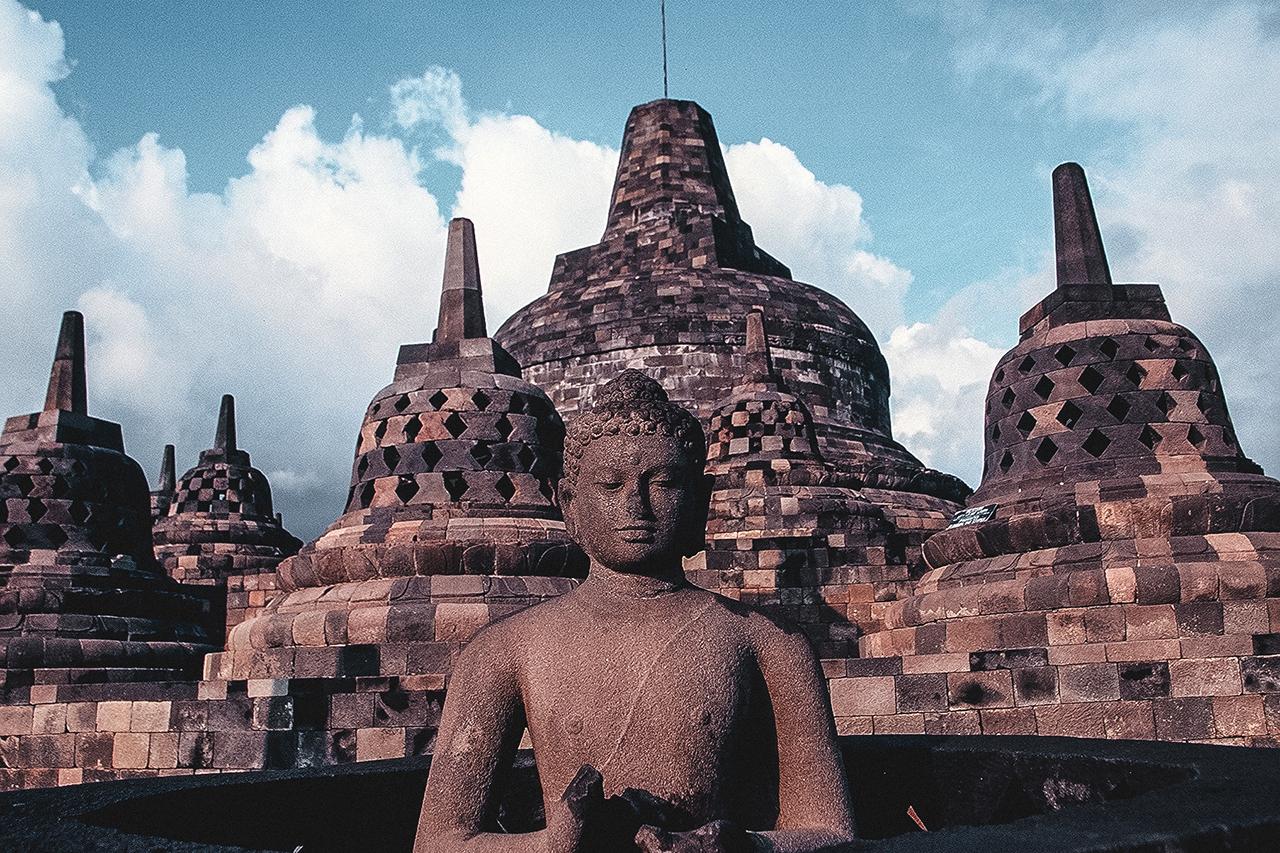 Buddha and stupas at Borobudur in Yogyakarta, Indonesia.