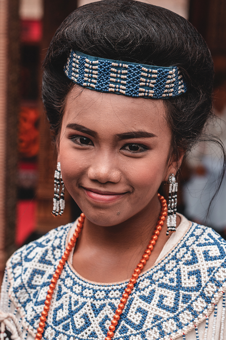 Girl dressed in traditional attire at a funeral in Toraja, Indonesia.