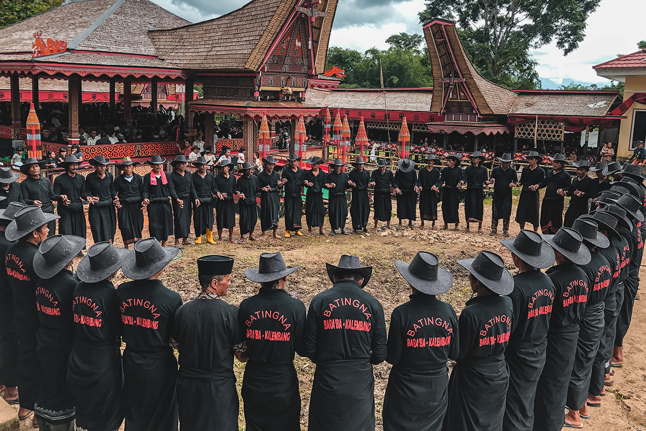 Men participating in the Ma' Badong funeral dance in Tana Toraja, Indonesia.
