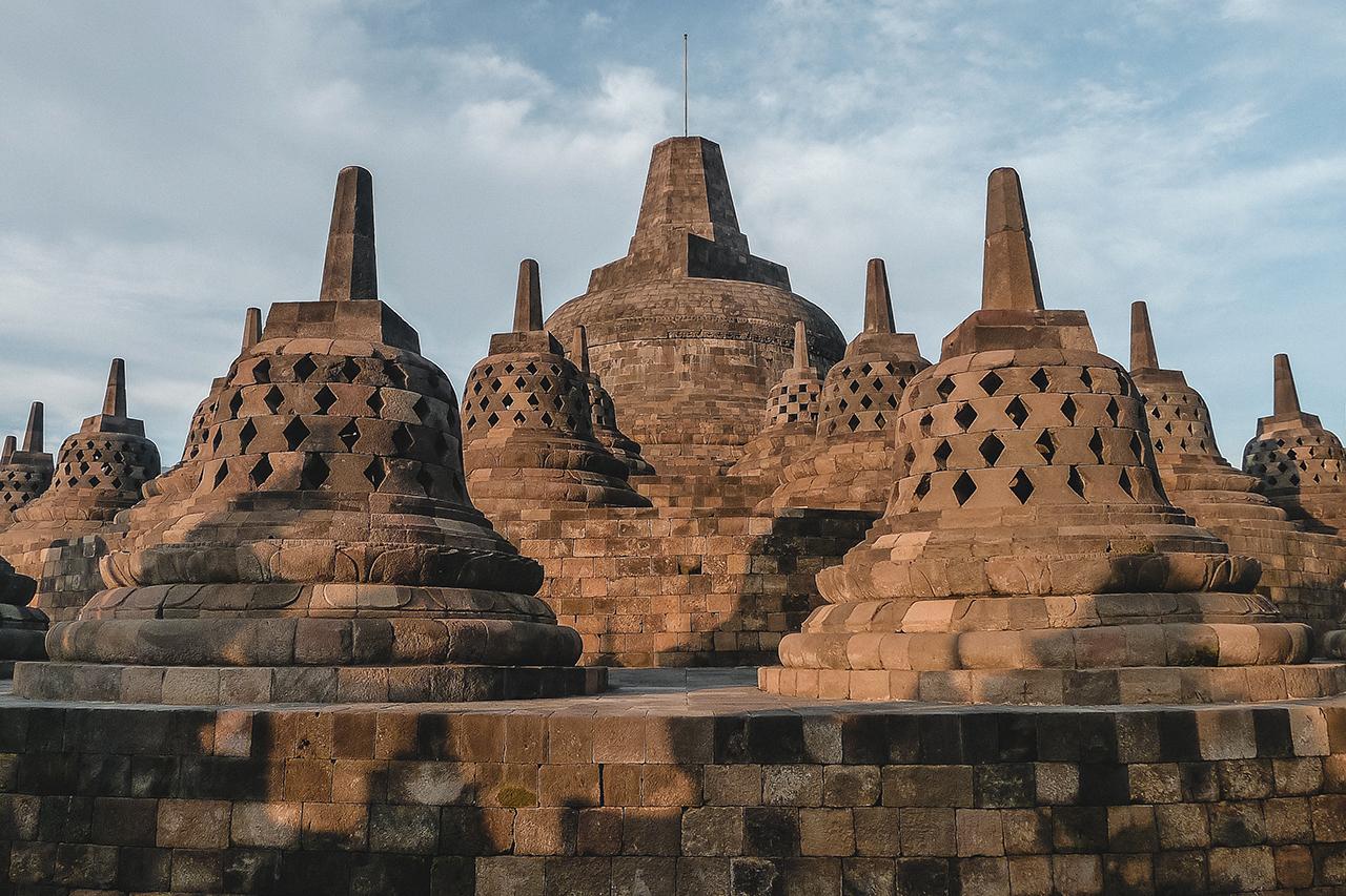 Stupas at Borobudur in Yogyakarta, Indonesia shortly after sunrise.