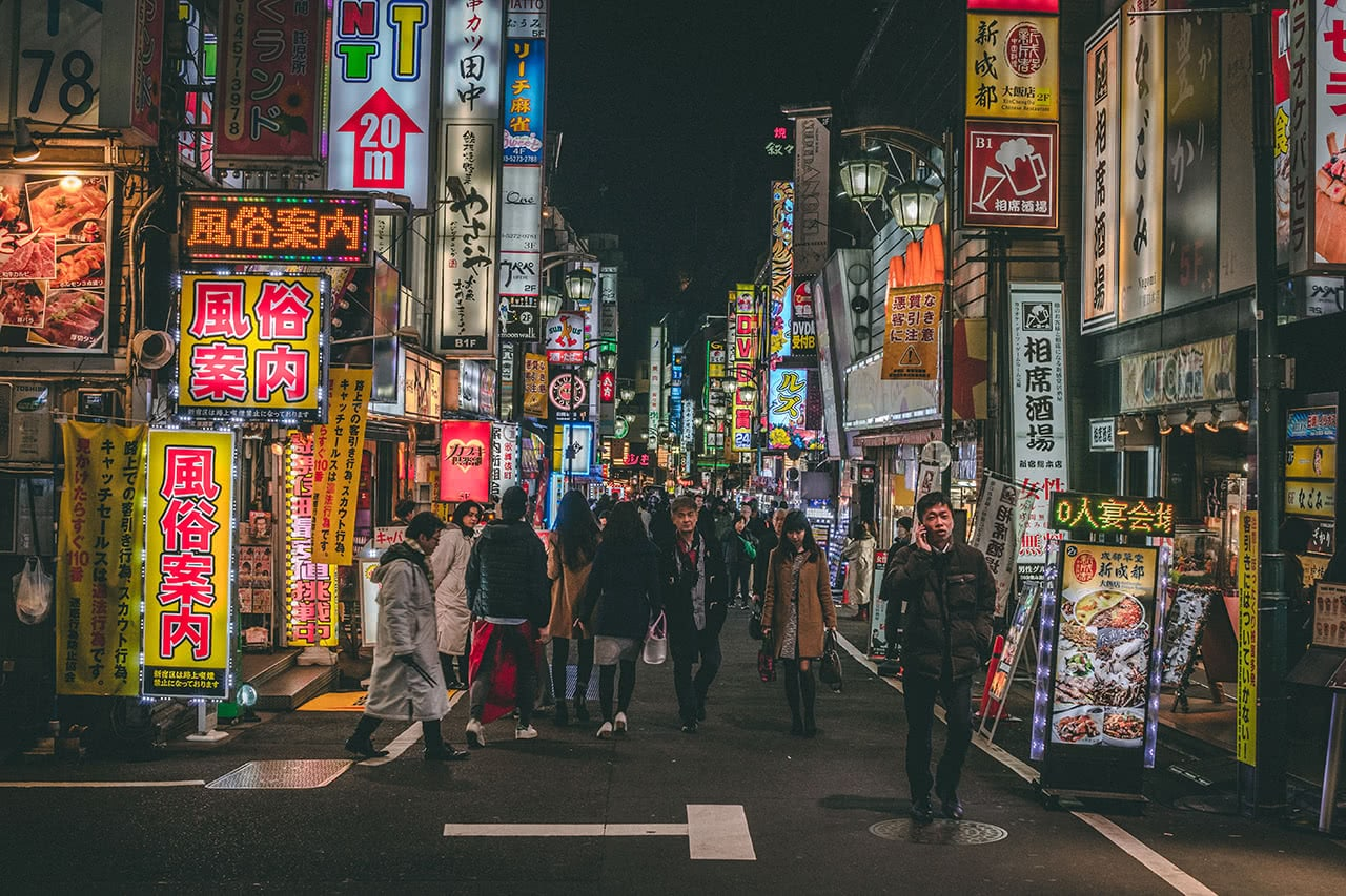 Street scene in Shinjuku at night.