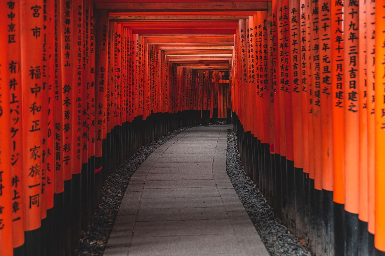 Thousands of orange gates at the Fushimi Inari Shrine in Kyoto, Japan.