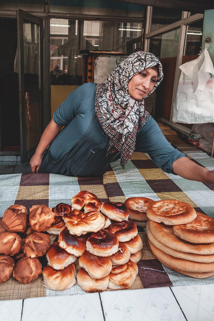 Woman selling bread at the Green Market in Almaty, Kazakhstan.