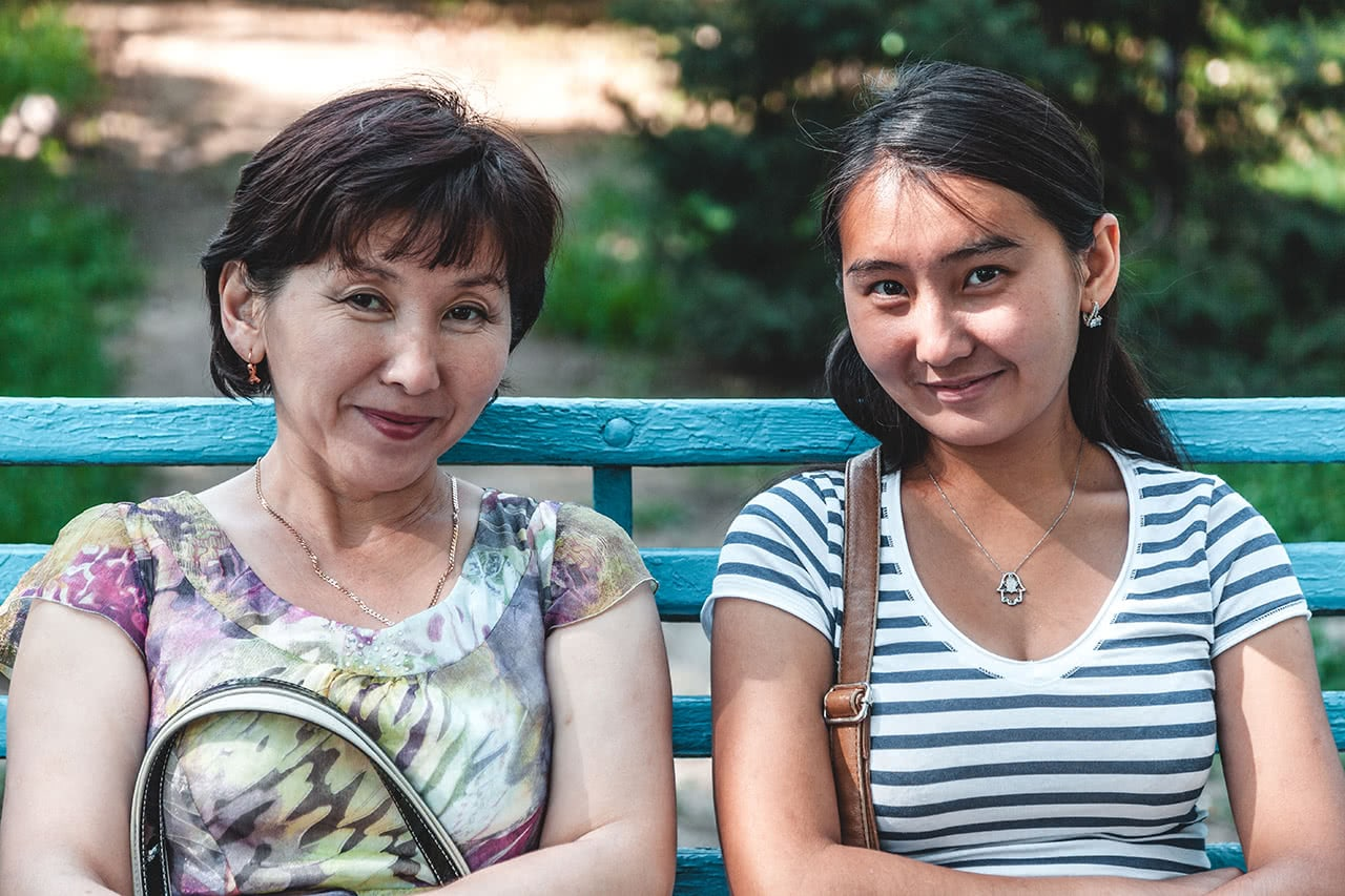 Mother and daughter sitting in the Park 28 Panfilovtsev in Almaty.