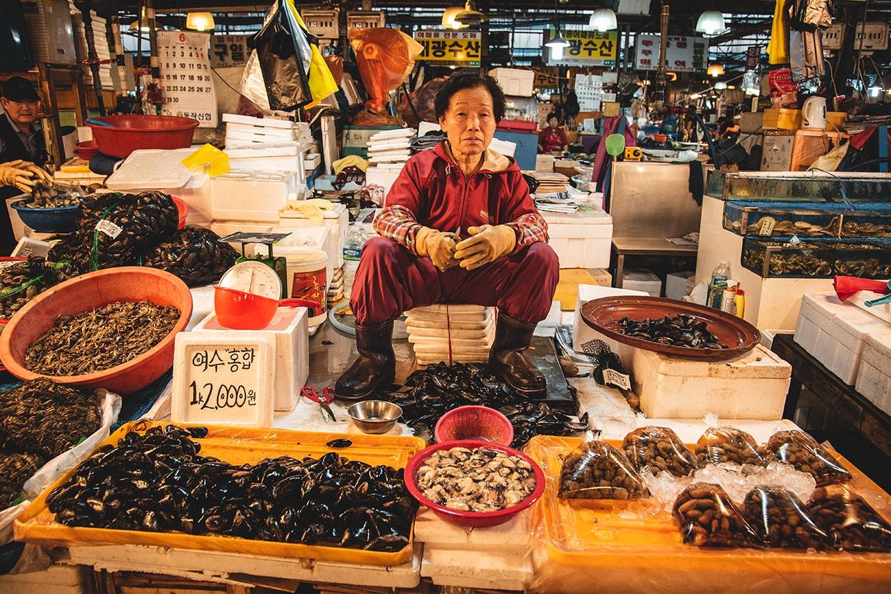 Vendor at Noryangjin fish market in Seoul, Korea.