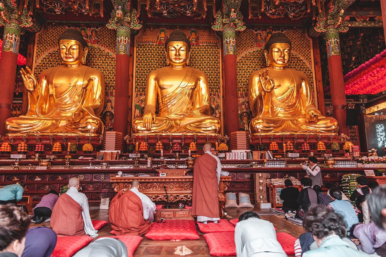 Buddhist prayers at Jogyesa temple in Seoul, Korea.
