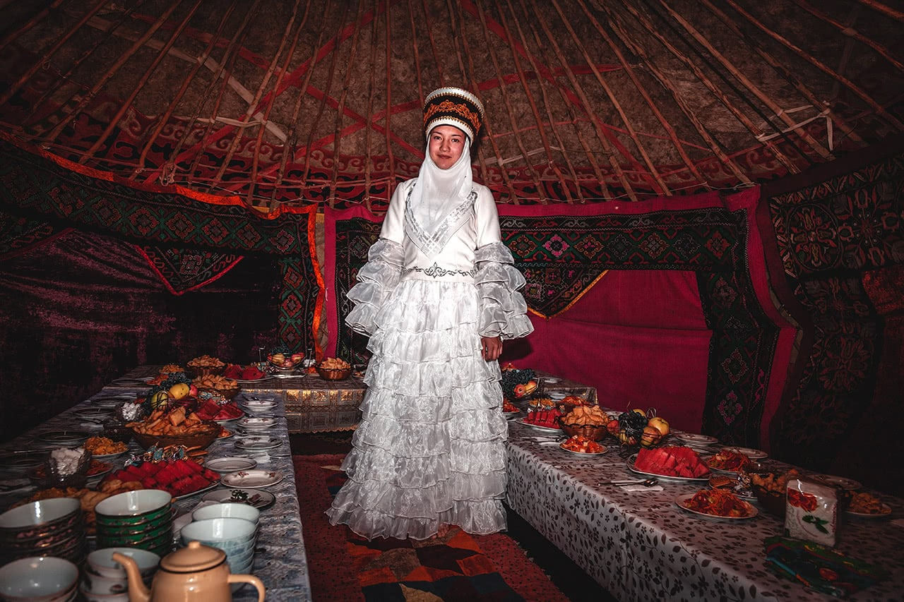 Krygyz woman in traditional dress at the National Horse Games Festival in Kyrgyzstan.