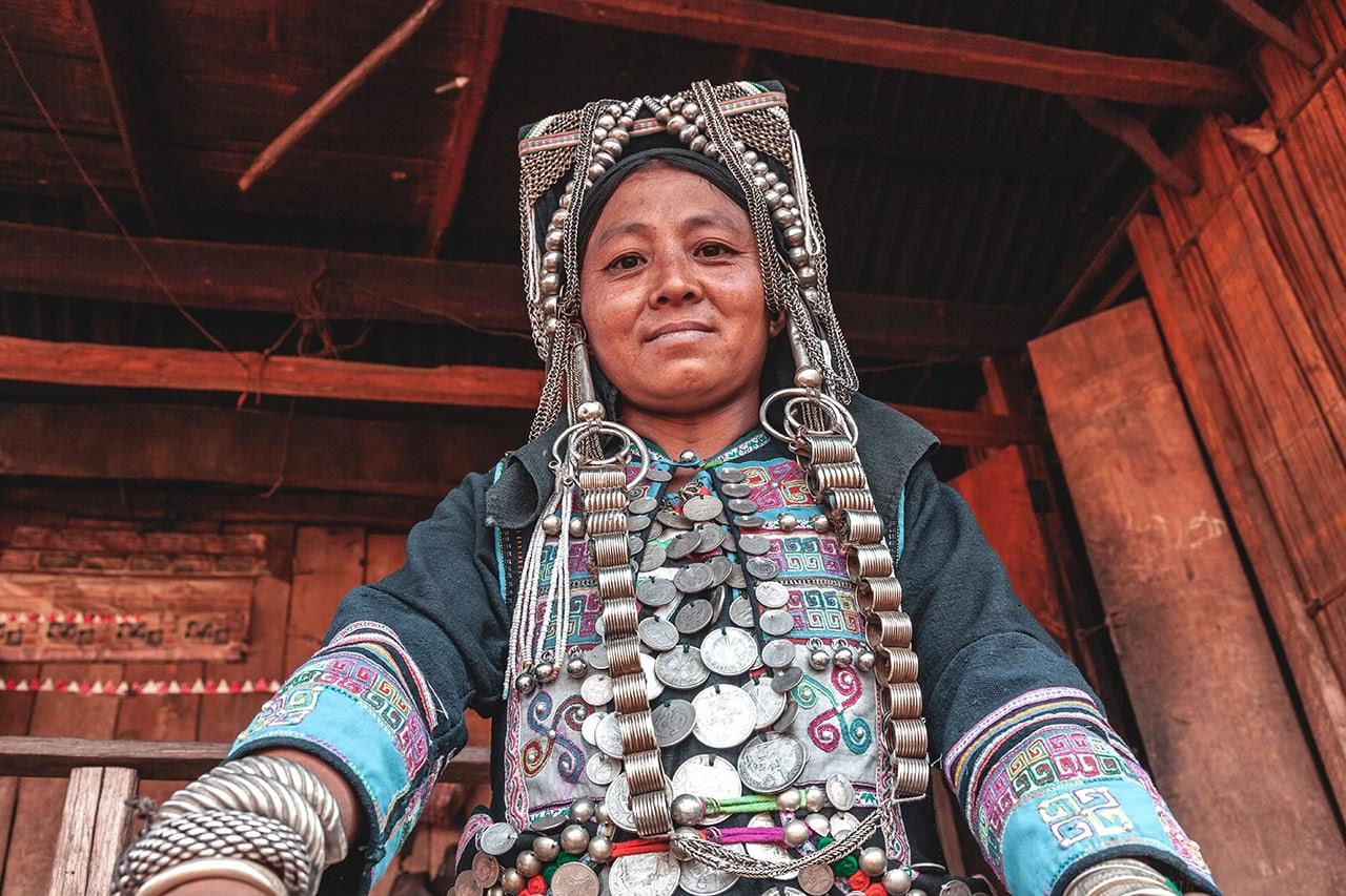An Akha Nouheau woman in Phongsali wearing traditional attire.