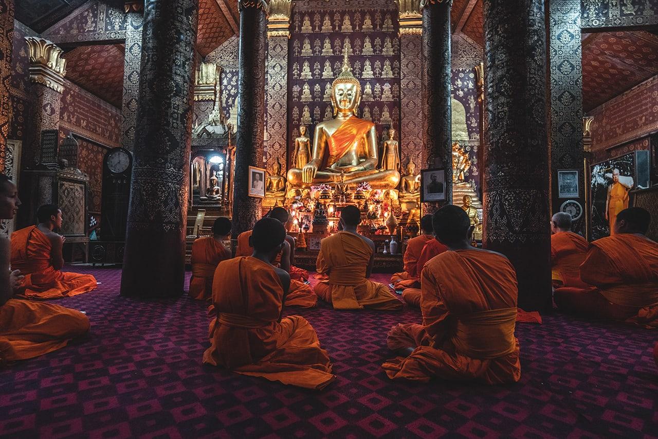 Monks chanting during evening prayer in Luang Prabang.