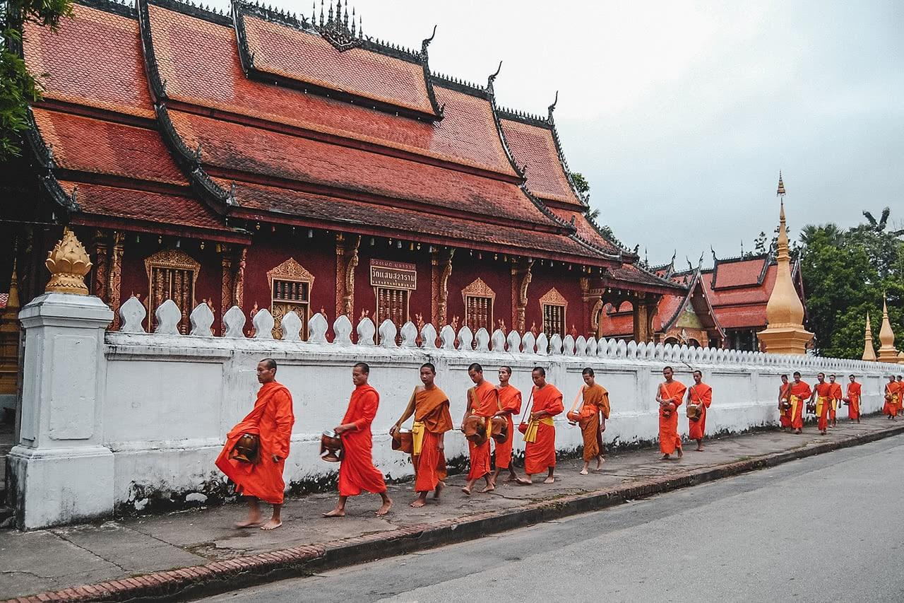 Monks beginning their sunrise walk through Luang Prabang to receive alms.
