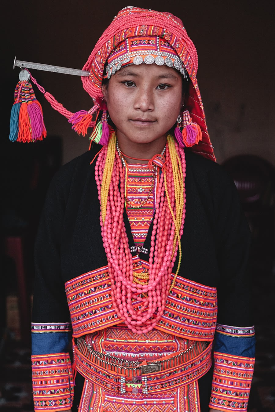 An Akha Loma girl wearing traditional clothing in Muang La, Laos.