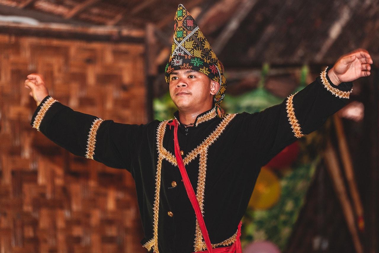 Traditional Iban dancer, Kota Kinabalu, Malaysia.