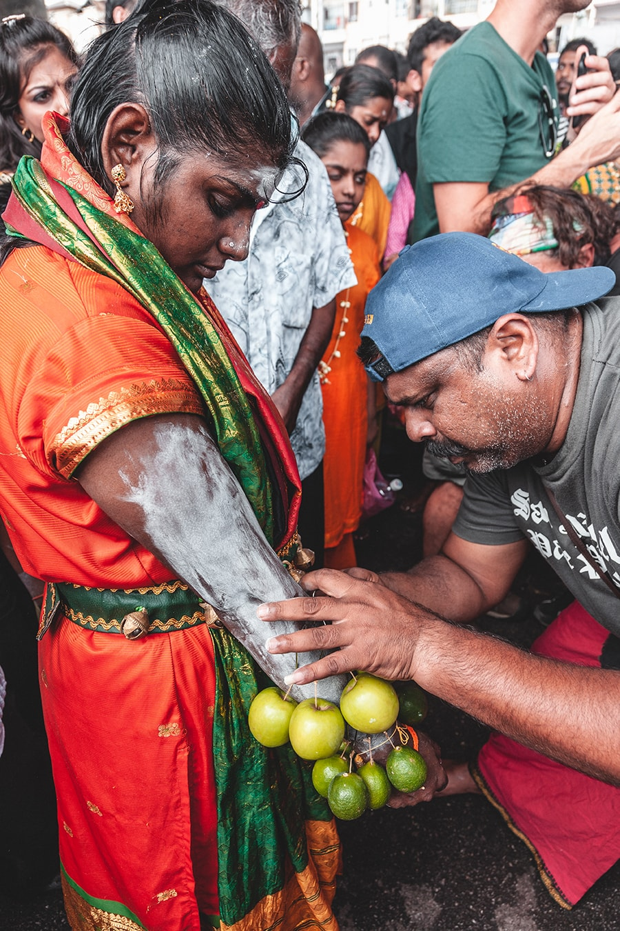 A woman pierced her arm with apples on hooks as an act of devotion during the Thaipusam festival in Kuala Lumpur, Malaysia.