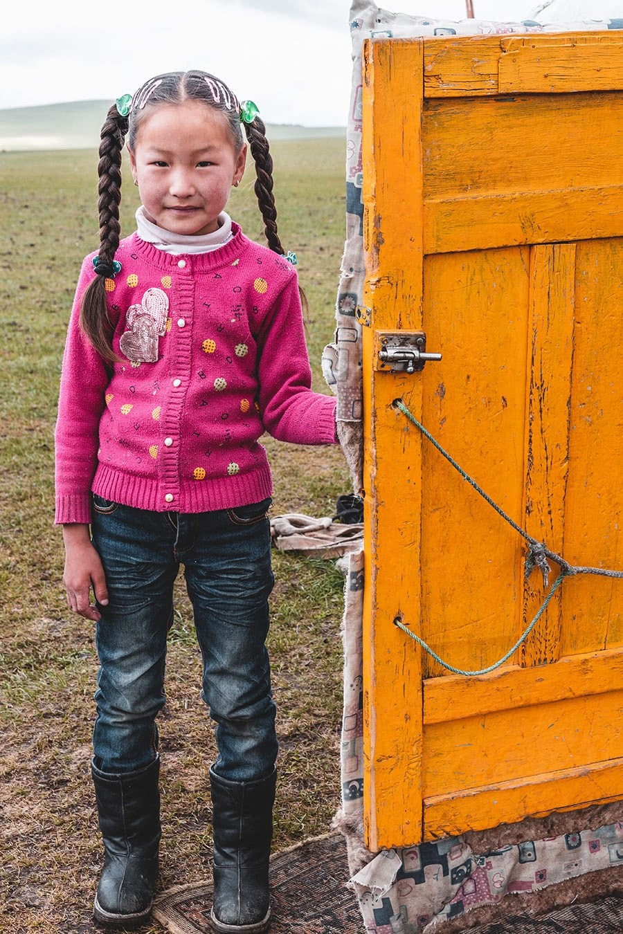 A Mongolian girl at her ger in Bayan Ulgii province, Mongolia.