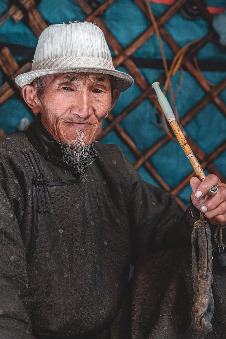 A Myangad Mongol man smokes in his ger in Altan Hokhii, Mongolia.