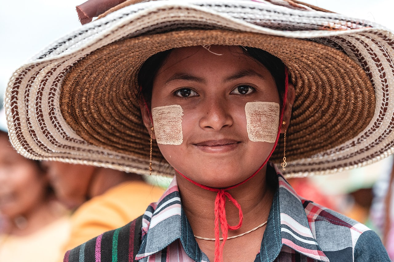 A Burmese girl sporting traditional thanaka powder on her face.