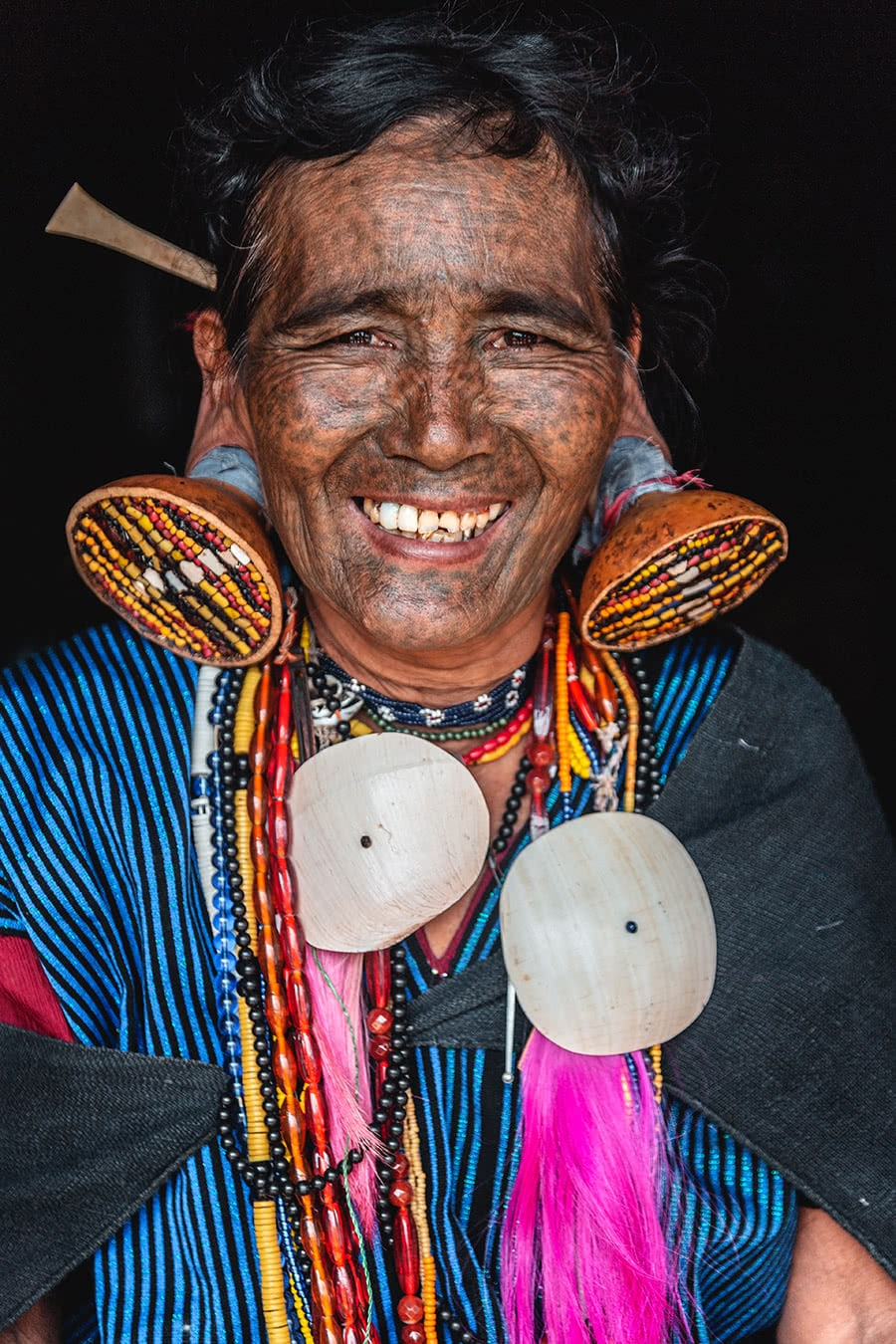 A M'kuum woman from Mindat, Chin State, with distinctive facial tattoos and clothing.