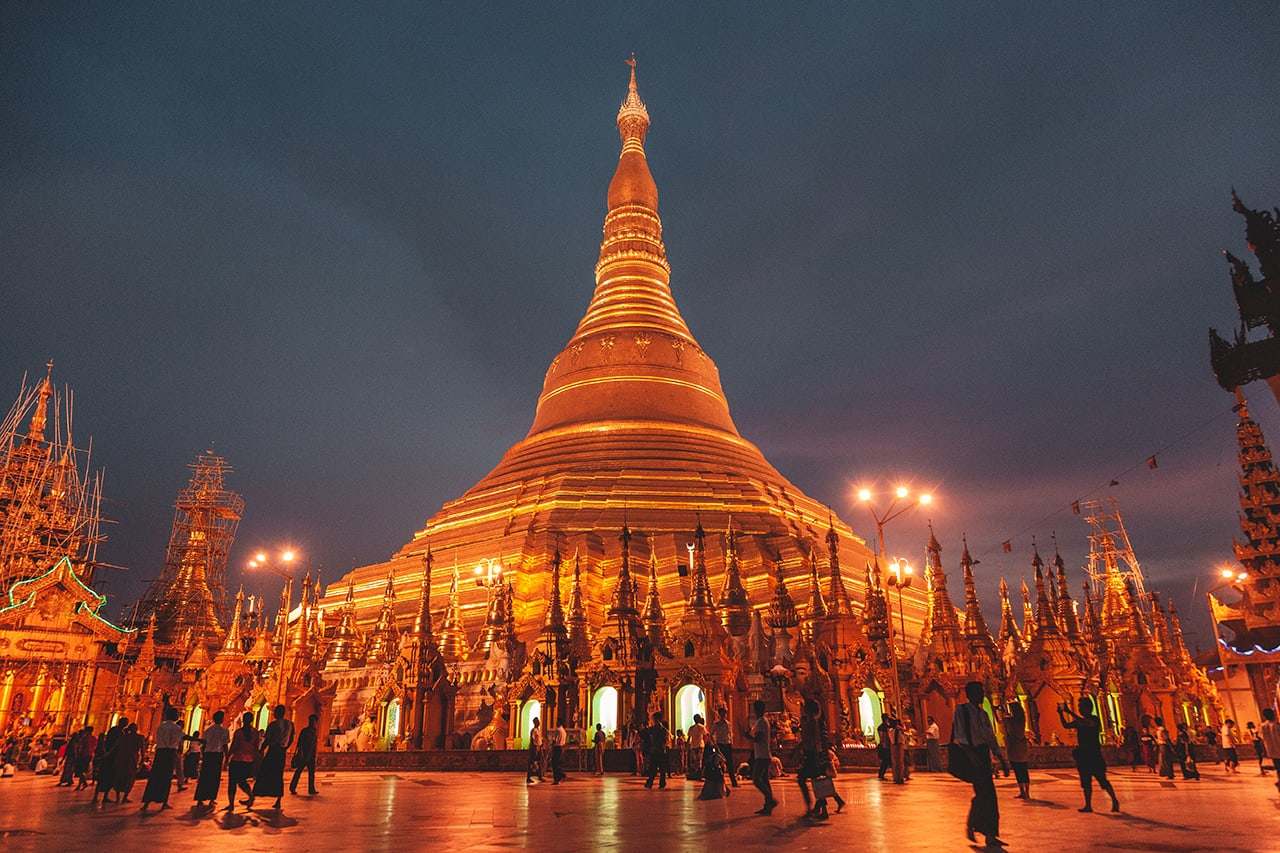 The golden Shwedagon Pagoda lit up at night.