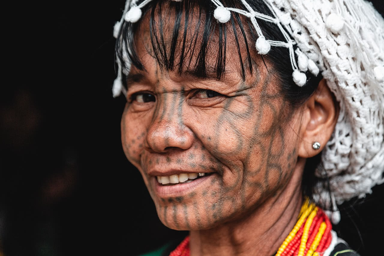 A Munn Chin woman in Mindat, Myanmar with traditional facial tattoos.