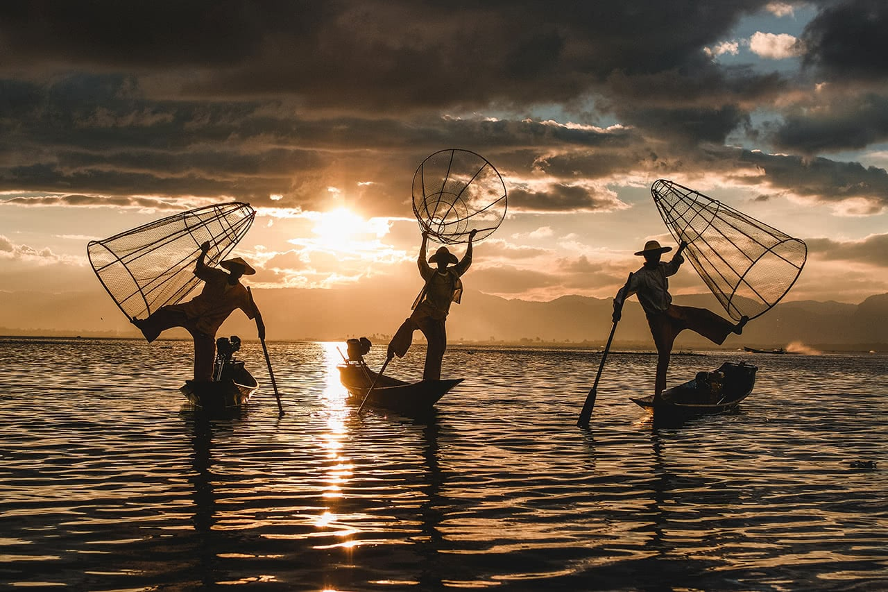 Fisherman at Inle Lake display their unique nets as the sun sets.
