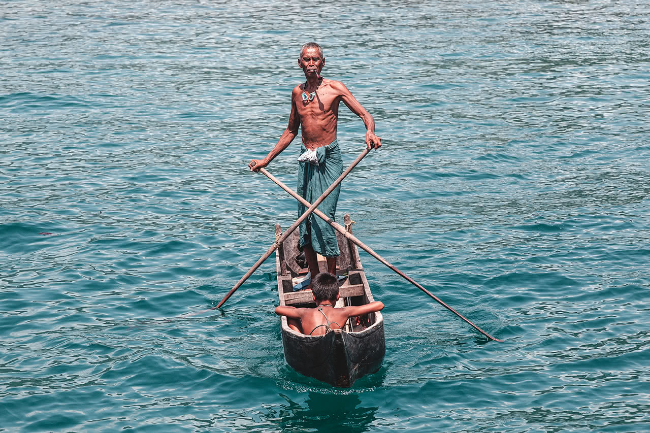 A Moken man rows his boat the traditional way in the Mergui Archipelago, Myanmar.