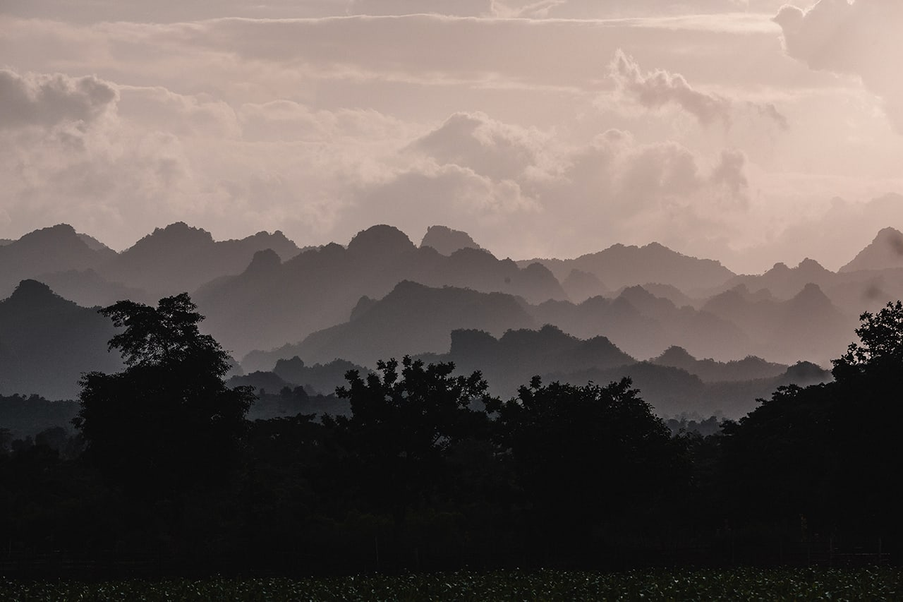 Remote hills of Kayah State in Myanmar as the sun sets.