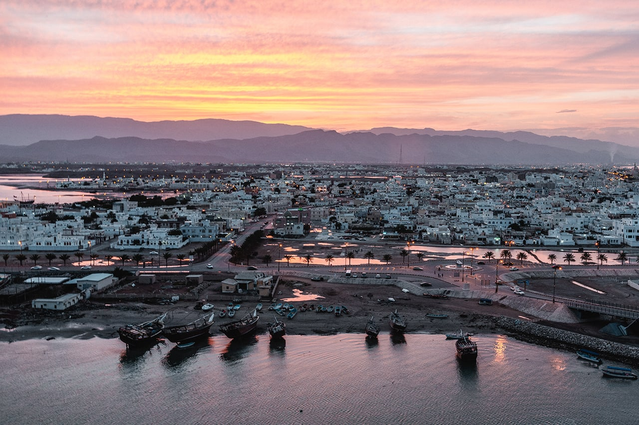 Looking over the former Portuguese city of Sur in Oman as the sun sets.