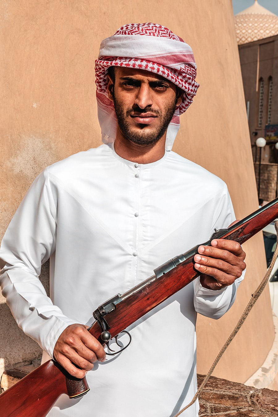 A man holding a riffle at the Niza Gun Market in Oman.