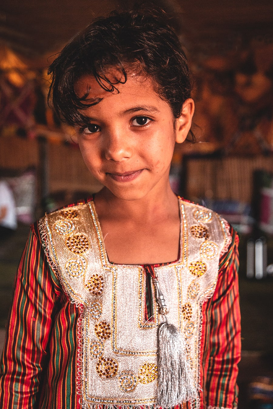 A bedouin girl in the Sharqiya Sands, also knowns as the Wahiba Sands.